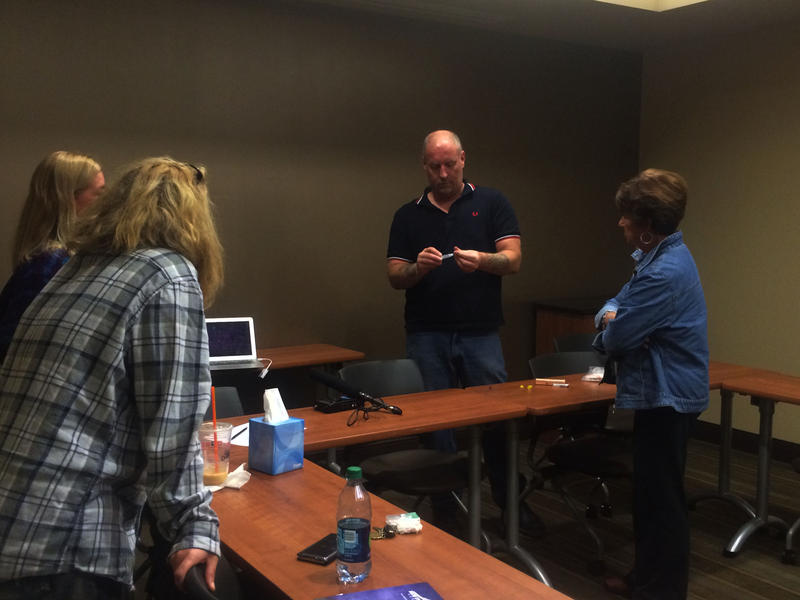 John Burns teaches a training session for family members who want to get a Narcan presription.