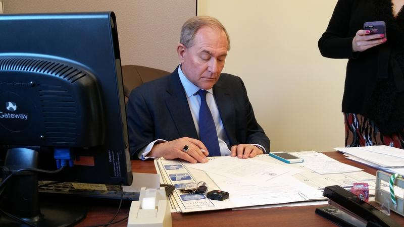 Jim Gilmore, Republican candidate for president, fills out the paperwork needed to get on the New Hampshire primary ballot in Concord Monday.