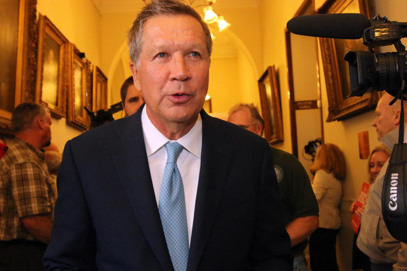 Ohio Governor John Kasich speaks with the media after filing for the 2016 N.H. Primary