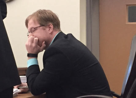 Physician Assistant Chris Clough listens to testimony at his disciplinary hearing before the Board of Medicine in March.