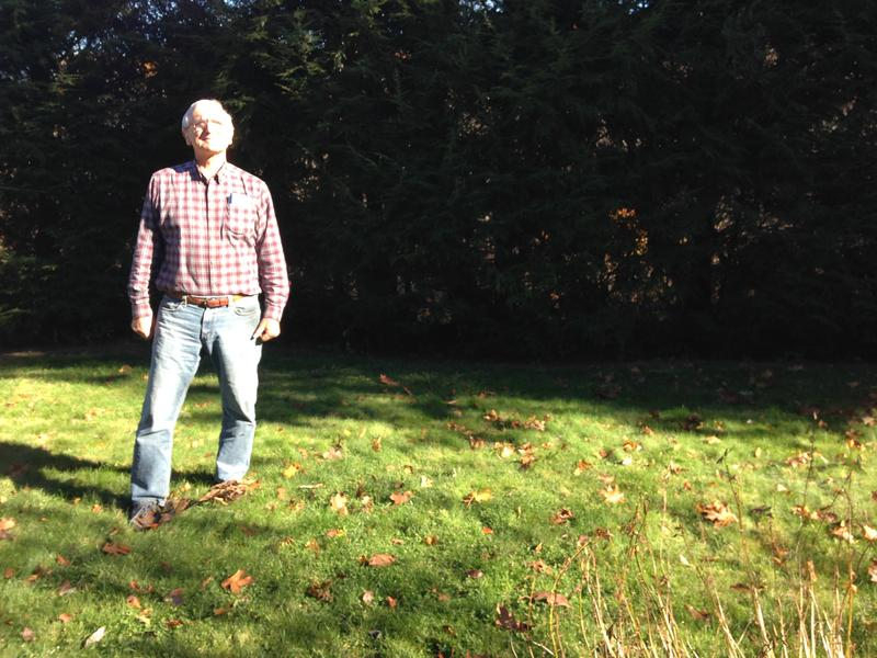Rich DiPentima stands in his yard, 100 feet from Pan Am's railroad tracks.