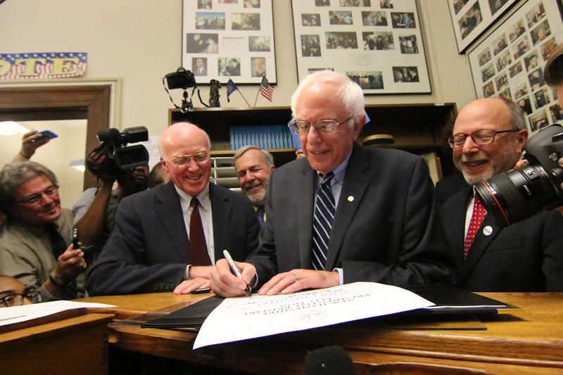 "Vermont Sen. Bernie Sanders joked with Bill Gardner about his required $1,000 fee. ""And the check won't bounce - it's a good check,"" said Sanders laughing."
