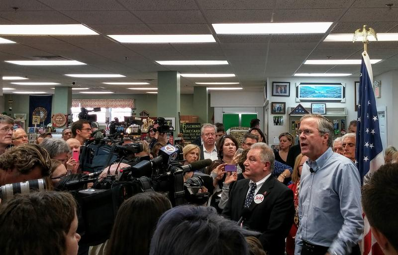 Bush addresses the media at the Hollis Pharmacy, a popular campaign stop for GOP N.H. Primary candidates
