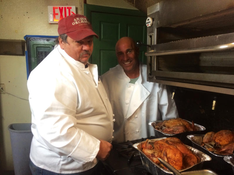 Chuck Kalantzis (right) cooks 26 turkeys every year to serve those in need in Manchester.