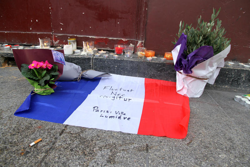 "Tributes to victims of the attacks in Paris, November 13, 2015. The Latin phrase ""Fluctuat nec mergitur"" is the motto of Paris, loosely translating as ""She is tossed by the waves, but does not sink."""