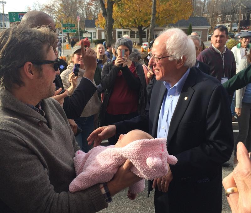 During a few minutes of shaking hands, Sanders is presented with a baby who he declines to kiss.