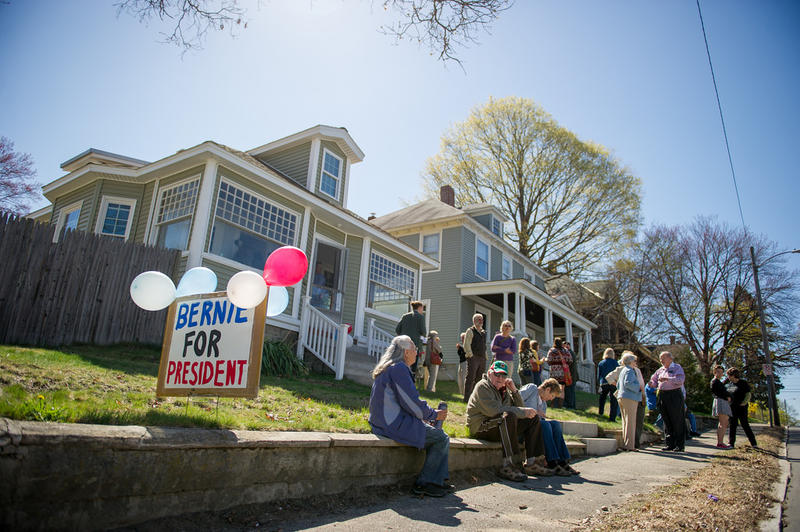 Supporters wait outside a house party for Vermont Senator Bernie Sanders in Manchester.