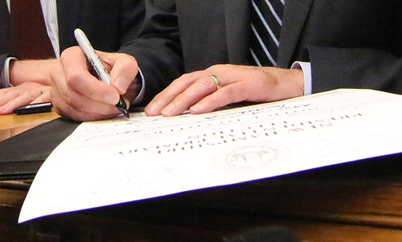 Those are Vermont Senator Bernie Sander's hands signing the customary certificate in Secretary of State Bill Gardner's office