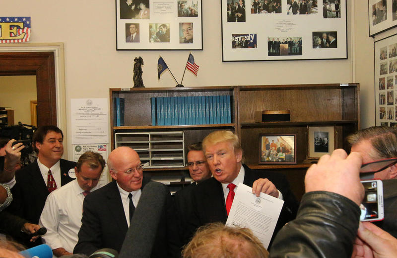 While filing, businessman Donald Trump also joked with Bill Gardner that the check he's using to file for president is through a bank that, he says is not as rich as him.