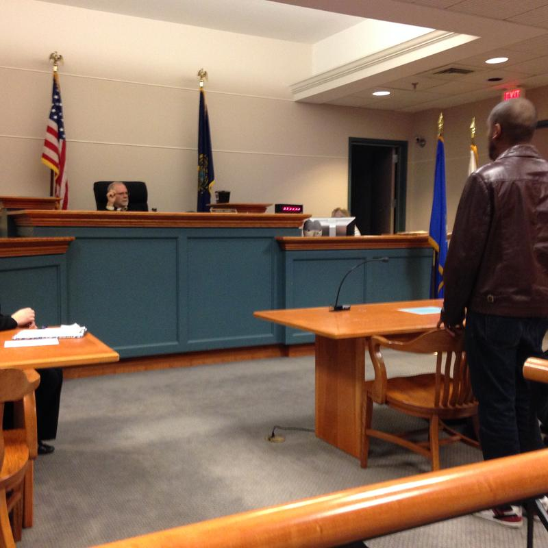 Dominiq Russell (right) stands before Judge James Leary at the veterans' court at the 9th Circuit Court in Nashua.
