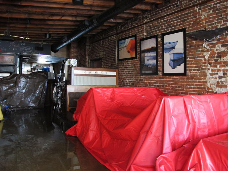 Inside the Gas Light, water rained down onto furniture protected by tarps.
