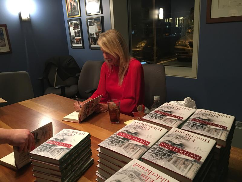 Elin Hilderbrand signs books before her Writers at the Loft event