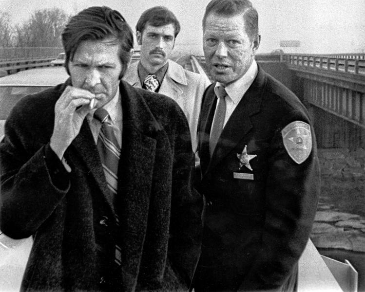 Robert Breest, on trial for the murder of Manchester teen Susie Randall in 1973, smokes a cigarette during a jury view at the bridge on Interstate 93 in Concord where Breest was accused of having dropped Randall's body onto the frozen Merrimack River.