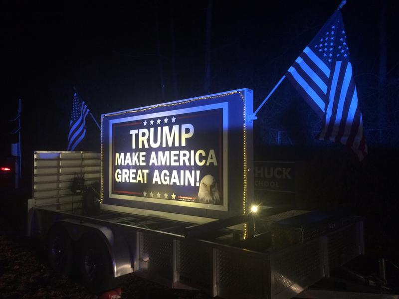 A sign sporting Donald Trump's campaign slogan was parked at the entrance to the event.