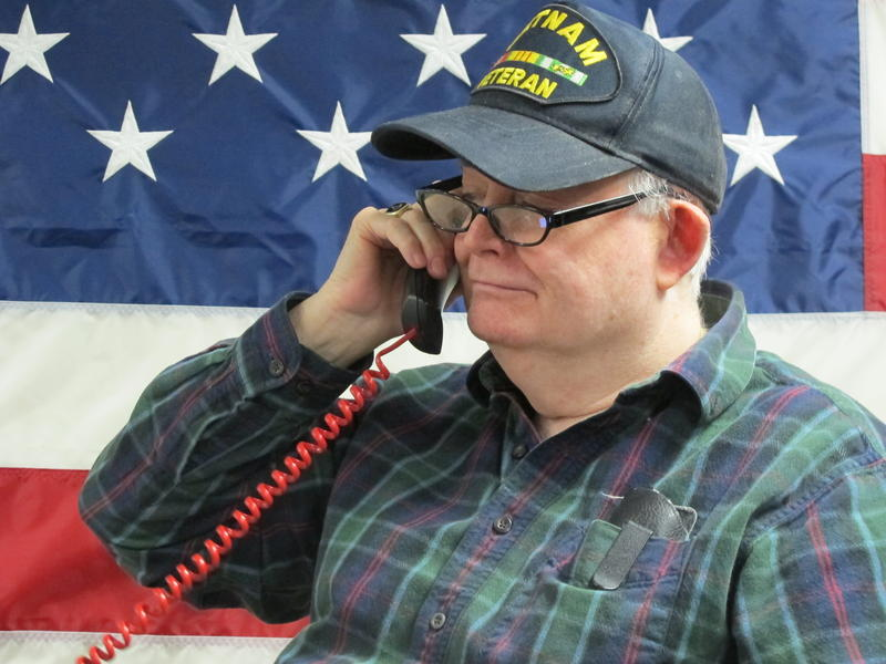 Barry Devine of Goffstown spends two days a week phone banking for Rand Paul