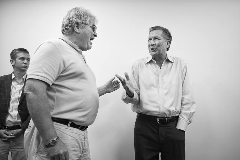 "Ohio Governor John Kasich (right) on the campaign trail in one of the images in the ""Candidates: Connections Made and Missed"" exhibit."