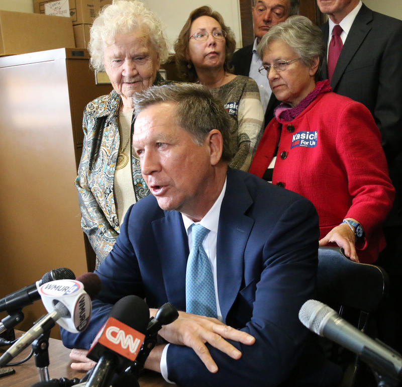 Kasich speaks to the press after filing his candidacy for the N.H. Primary