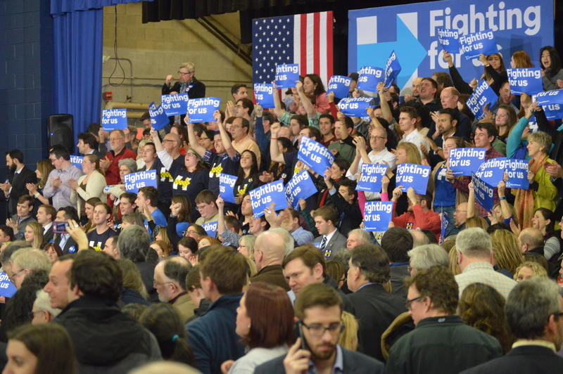Clinton supporters cheer in anticipation of her arrival at her SNHU campaign headquarters