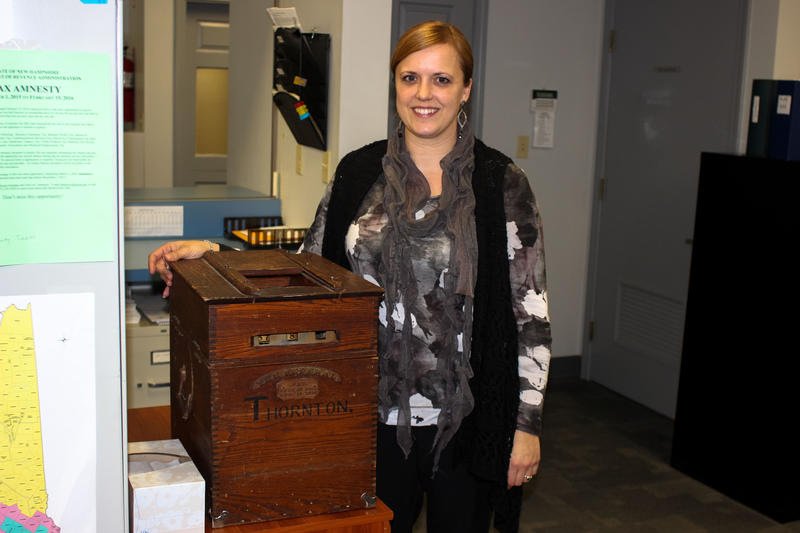 Thornton Town Clerk Brook Rose with the old voting box, in use since 1892.