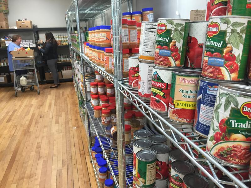 A volunteer helps someone at the Nashua Soup Kitchen and Shelter's food pantry.
