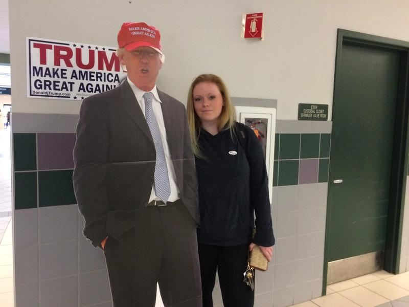 Sophomore Sophie Carrier poses with a cutout of Donald Trump