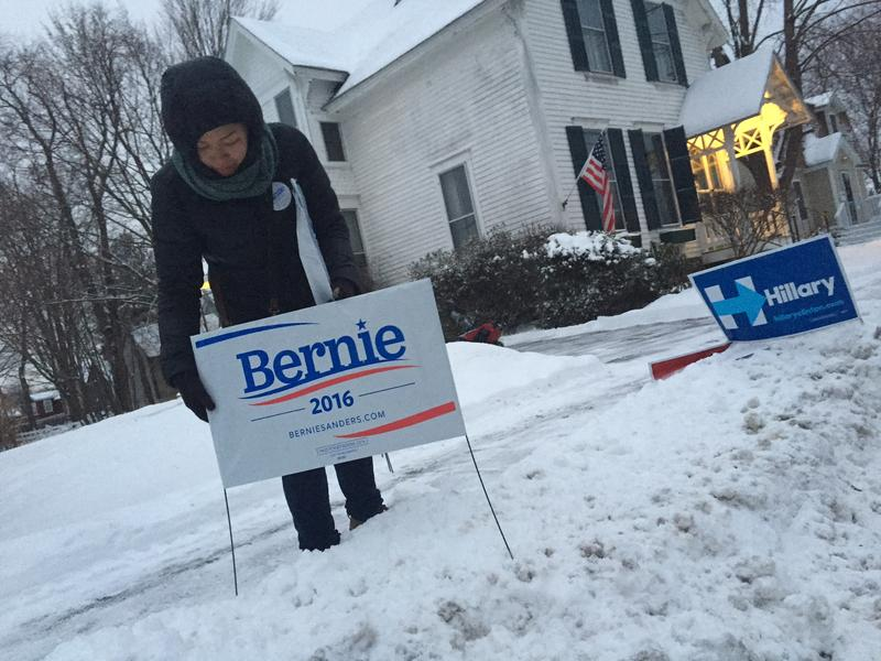 Bernie Sanders supporters placed signs outside Concord's Ward 7 this morning. Election officials later told them they needed to be removed because they were on public property.