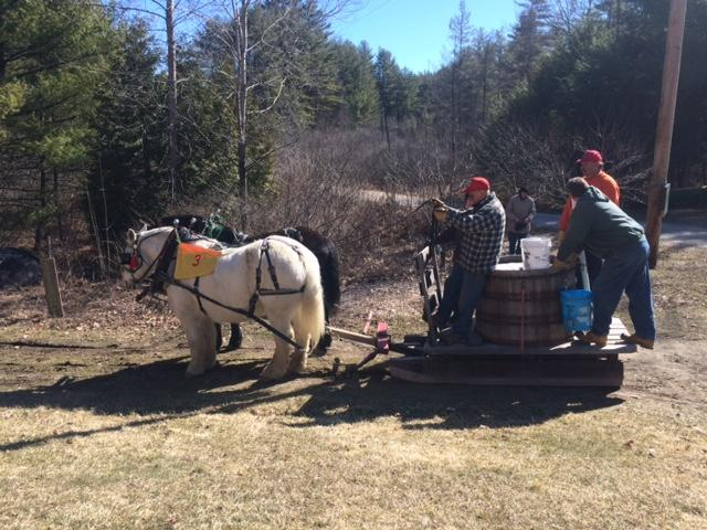 A team participates in the sap gathering contest at Stonewall Farm.