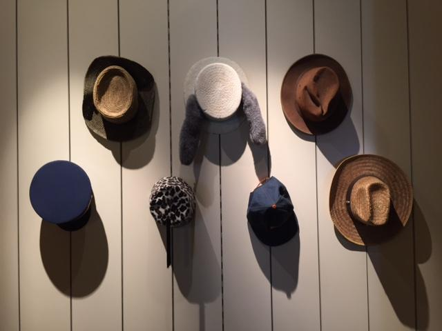 Founder Andrew Pinard decorated the walls with hats he collected from previous performances.
