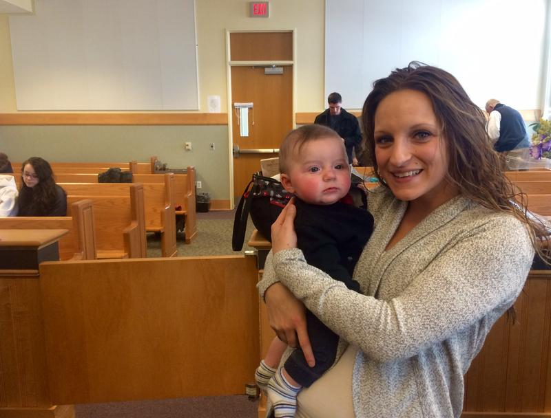 Kaitlyn Millette, 23, beams with joy while holding her son Brison after she graduated from Laconia's Recovery Court in February.
