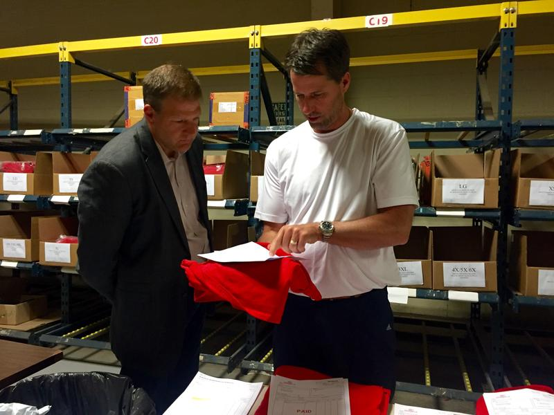Chris Sununu chats with Mark Lane, owner of Coed Sportswear in Newfields, during a recent tour of the factory.