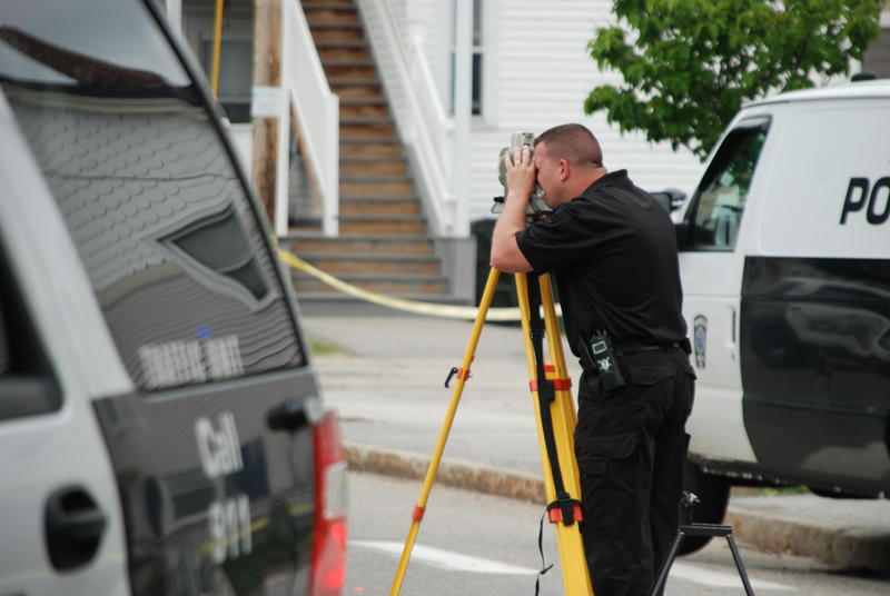 Police investigate the scene of a shooting on Ferry St. in Manchester, May 13, 2015