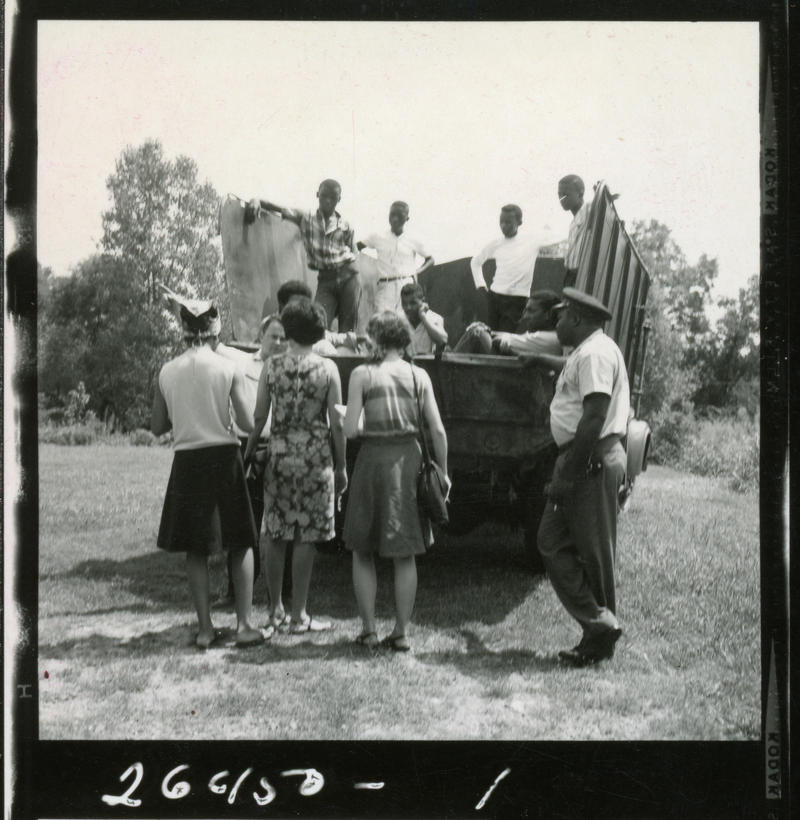 Protestors arrive at the Hayneville, AL, jail in a garbage truck after being arrested in Fort Deposit. Jonathan was among those arrested. Stokely Carmichael is sitting in the lower right side of the truck. COURTESY:  Jonathan Daniels Collections, Mason Li