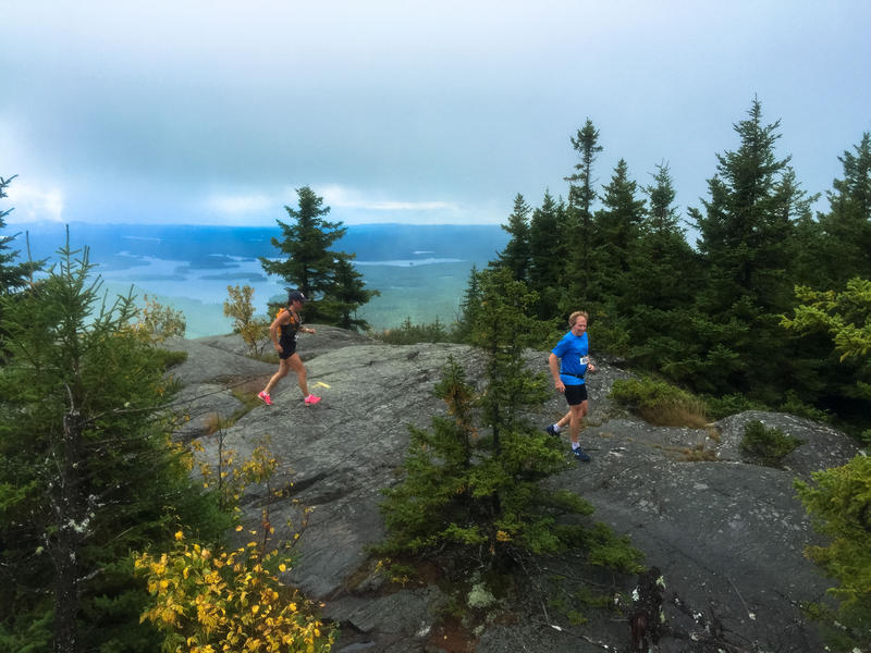 Michelle Eastman from Holderness and Bill Nesheim from Windham running over the crest of Mount Percival.