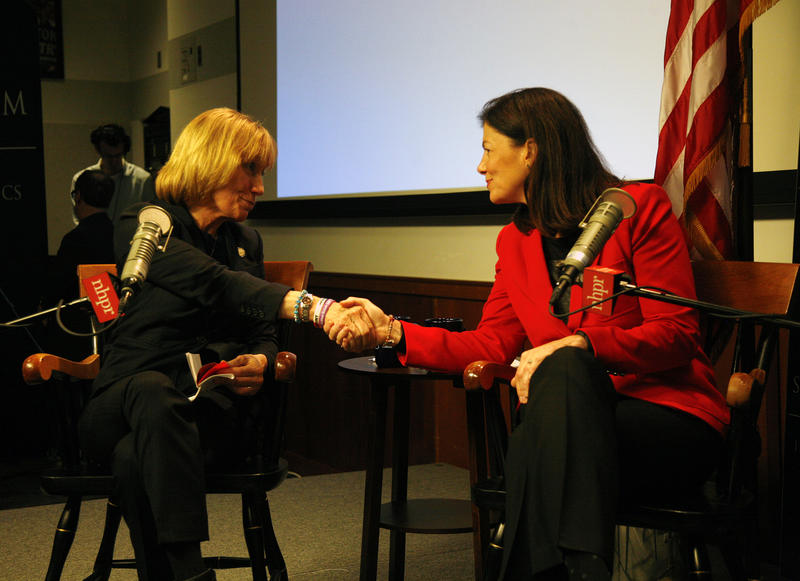 Governor Maggie Hassan and Senator Kelly Ayotte shake hands at the forum