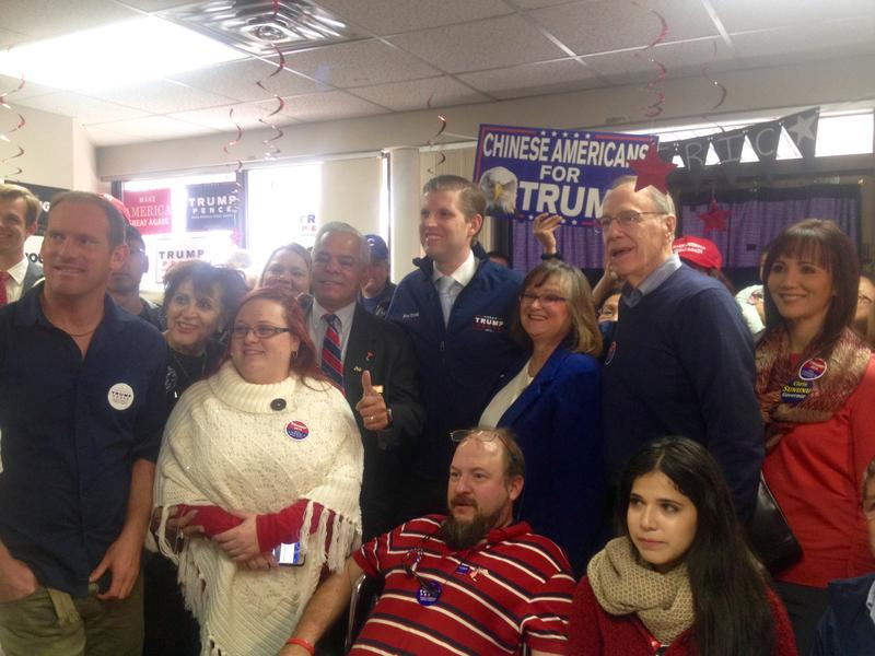 Eric Trump poses with his father's supporters at the Manchester campaign office.