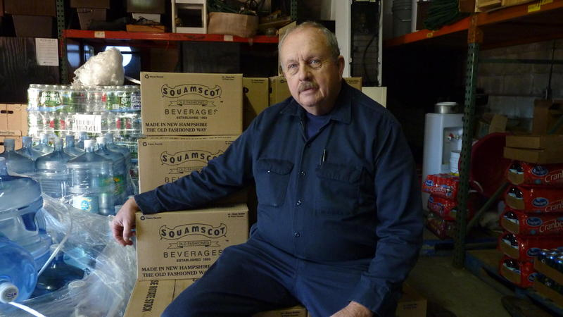 Tom Conner, the fourth generation to run Conner Bottling in Newfields, sits inside his warehouse.