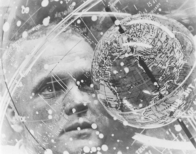 "In February 1962, Astronaut John H. Glenn Jr. looks into a globe, technically the ""Celestial Training Device"" at the Aeromedical Laboratory at Cape Canaveral, Florida."