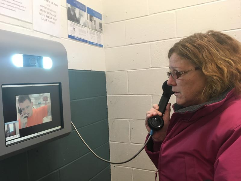 Dawn Herbert of Keene talks with her son Tommy Rogers through a video terminal at Cheshire County Jail. The video visits have taken the place of in-person visits.