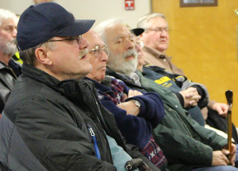Veterans listen to a presentation on changes proposed to veterans' health care in nothern New Hampshire at the Colebrook town clerk's office.
