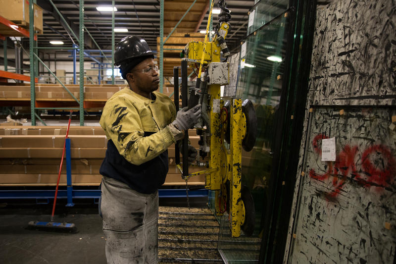 SIGCO worker Antonio Pedro came to the United States from Angola three years ago.  The company says immigrant employees reduce Maine's workforce shortage.