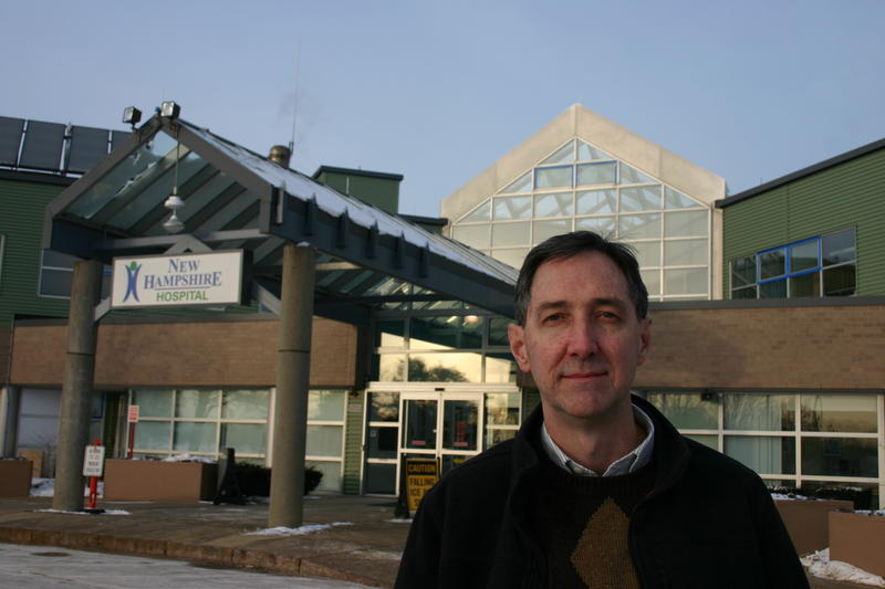 John Dixon stands before New Hampshire Hospital, where his son is currently a patient.