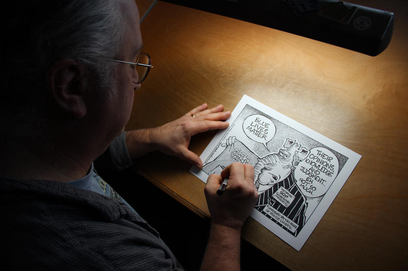 Mike Marland working on his final editorial cartoon for the Monitor.