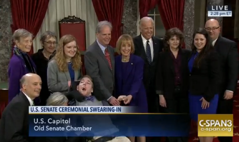 Sen. Maggie Hassan and family members pose with Vice President Joe Biden following her swearing-in as senator on Tuesday.