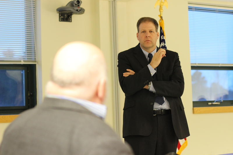 Larry Vogelman of the Veterans Law Project speaks with Governor Chris Sununu at a meeting of the State Veterans Advisory Committee on Tuesday, February 21, 2017.