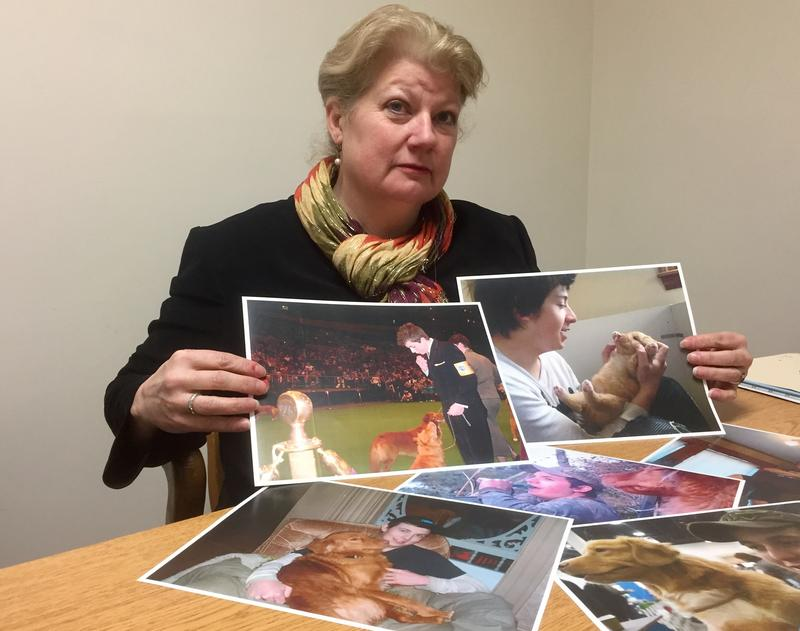 Judy Tilton holds up photos of her son Seth Tilton-Fogg, 21, who died in 2015 after injecting heroin laced fentanyl dealt by Brian Watson, 52, of Northfield.
