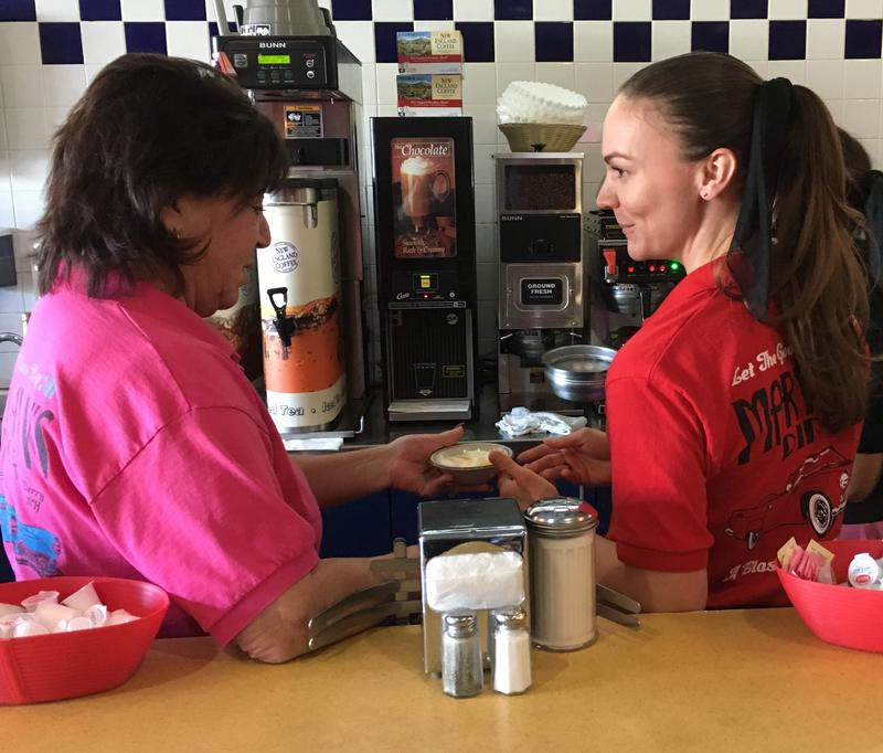 Linda Guilmat, manager at MaryAnn's Diner, and her colleague, working.