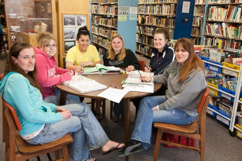 White Mountain Community College students in the library.