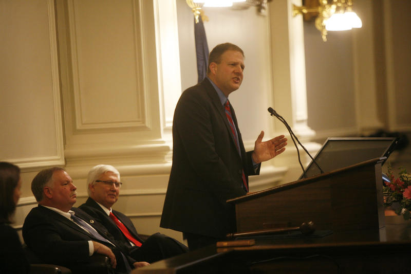 Governor Chris Sununu speaks at his January inauguration. Pictured behind him is house speaker Shawn Jasper and state senate president Chuck Morse