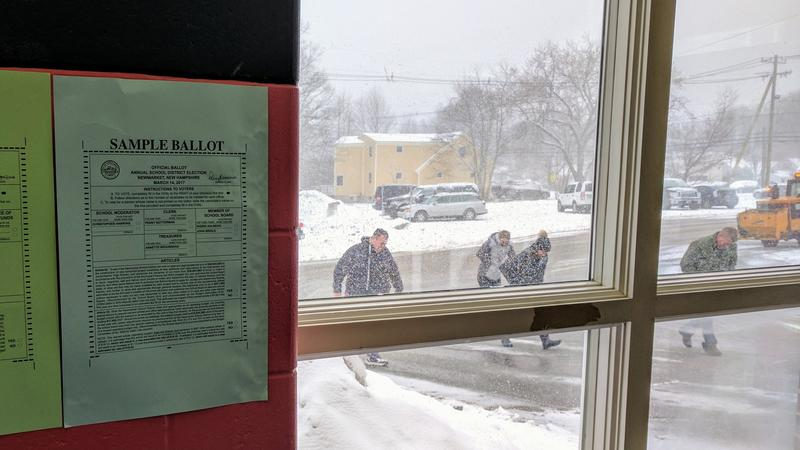 Voters in Newmarket brave the elements to cast a ballot on Tuesday.