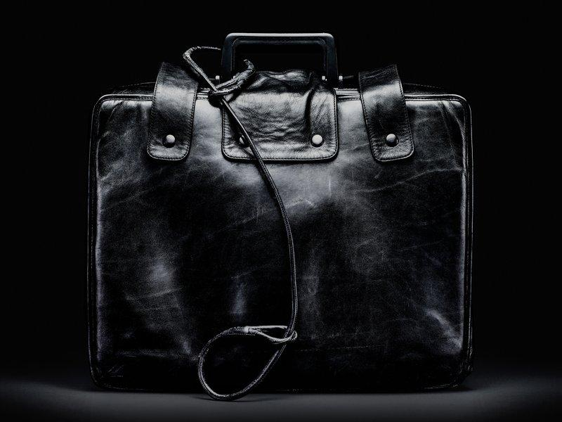 The nuclear football (also known as the atomic football, the president's emergency satchel, the button, the black box, or just the football) is a briefcase, the contents of which are to be used by the President of the US to authorize a nuclear